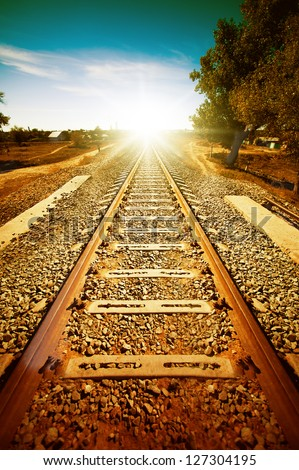 Old railroad to light. Retro style of picture - stock photo