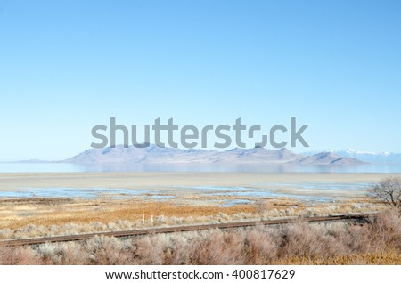Old Railway and Mountains on Bonneville Salt Flats - stock photo