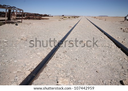 Old railway and trains in cemetery trains in desert, Uyuni, Bolivia, south America. - stock photo