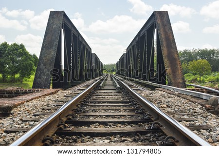 Old railway bridge. Focus at track. - stock photo