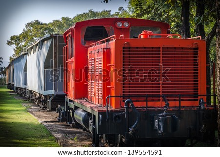 Old railway engine in orange for collection - stock photo