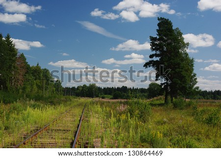 old railway in the fields - stock photo