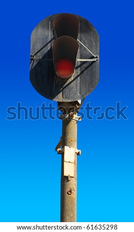old railway semaphore on a background of pure blue sky - stock photo