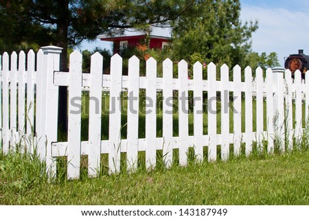 Old railway station and a white picket fence