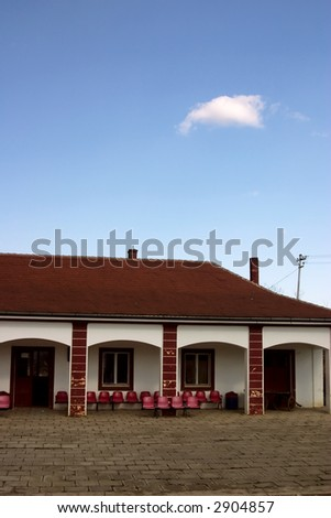 Old railway station building with red roof