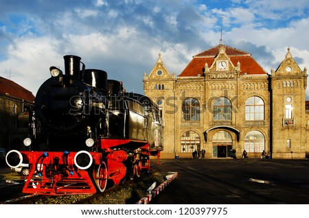 Old railway station with steam engine in front ( Arad, Romania, Europe) - stock photo