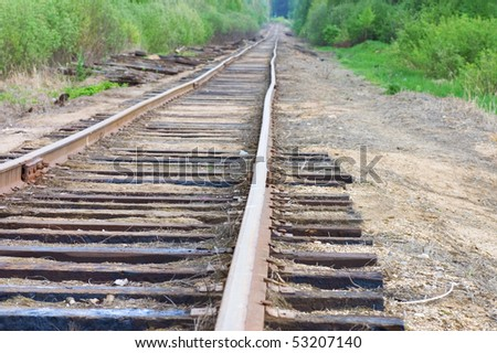 old railway track in the forest - stock photo