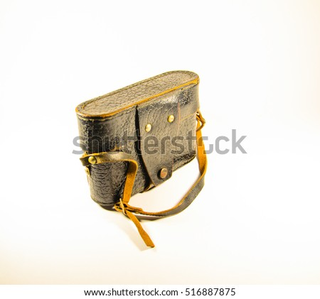Old rangefinder camera in leather case on white background