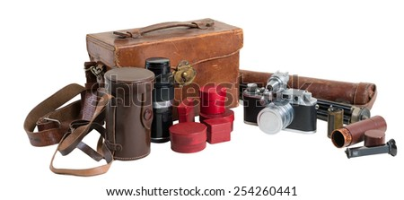 Old rangefinder camera with equipment on white background