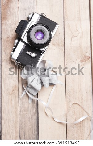 Old rangefinder vintage camera  isolated on white background,retro photo camera with bow ties for gift - stock photo