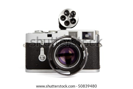 Old rangefinder vintage camera with wievfinder on white background - stock photo