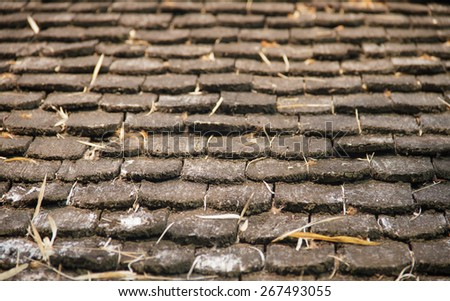 Old rasian wooden roof texture tiles made of terracotta background. - stock photo