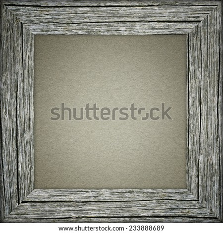 Old raw wooden frame with grey paper - stock photo