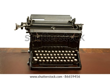Old reception area with an antique  typewriter on a table - white background - stock photo