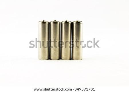 Old rechargeable battariesisolated on background AA type - stock photo