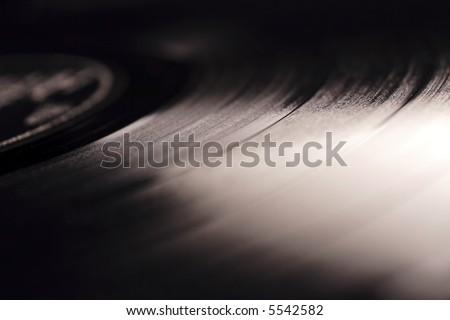 old record LP and player, shallow depth of field - stock photo