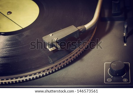 Old record player with vinyl disk - stock photo