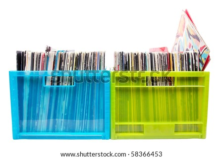 Old records in colour plastic boxes on white, closed up - stock photo