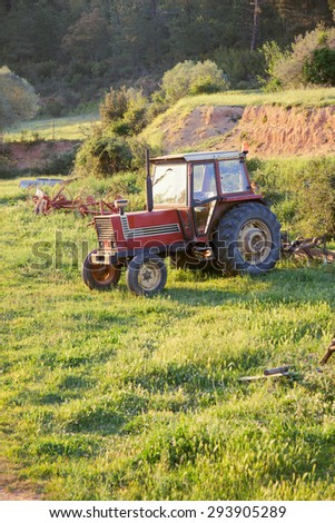 Old Red Abandoned Tractor  - stock photo