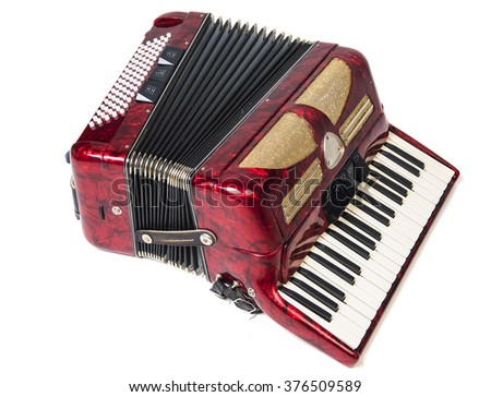 Old red accordion isolated on a  white background