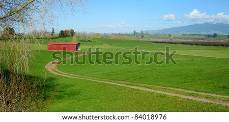 Old red barn in rural landscape - stock photo
