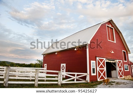old red barn on a farm - stock photo