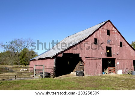 Old red barn on a farm in rural Missouri, USA - stock photo