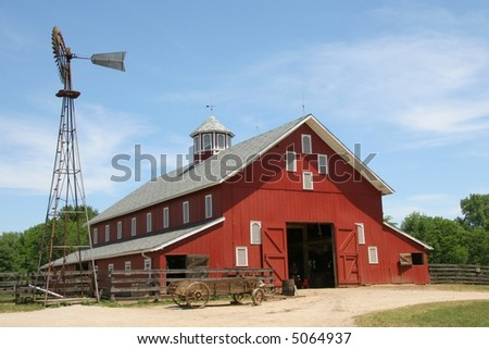Old Red Barn, Wagon, and Windmill - stock photo