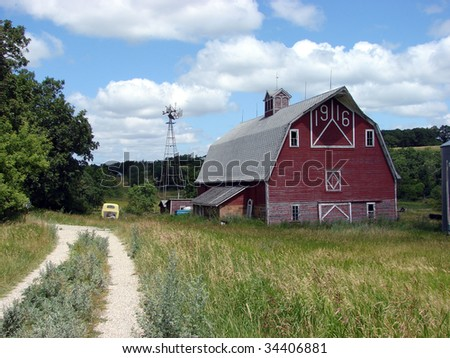 old red barn windmill - stock photo