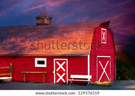 Old Red Barn with Bench and Well - stock photo
