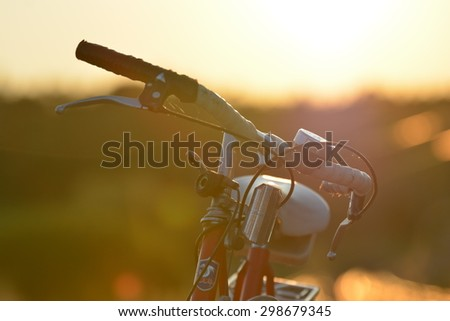 Old red bicycle with retro effect - stock photo