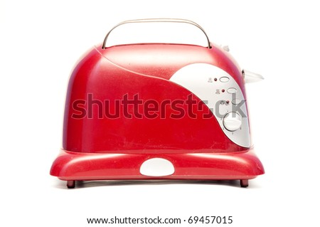 Old red bread toaster on white background - stock photo