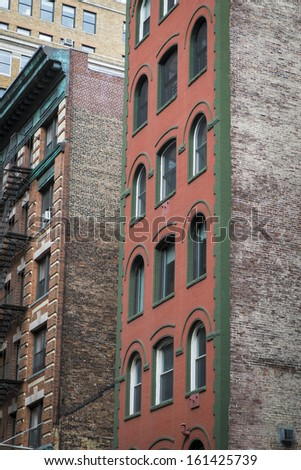 Old red brick apartment buildings in New York City - stock photo