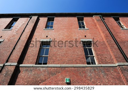 Old red brick building or factory - stock photo