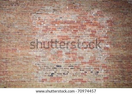 old red brick patched wall - stock photo