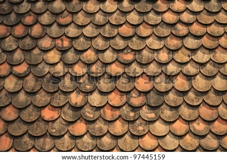 Old red brick roof tiles from north of thailand - stock photo
