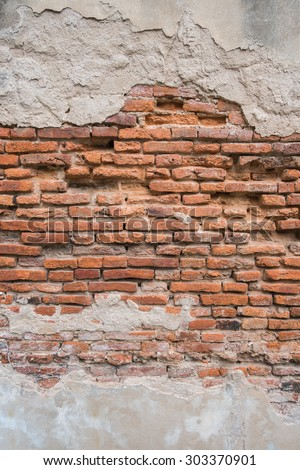 Old red brick wall. - stock photo