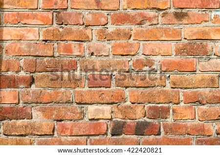 Old red brick wall background image - stock photo