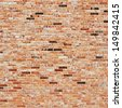 Old red brick wall fragment as a background texture - stock photo