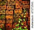 old red brick wall grown with grass and moss - stock photo