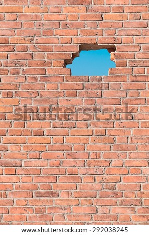 Old red brick wall with a hole; Striking new paths - stock photo