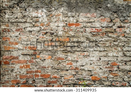 Old red brick wall with cement mortar - stock photo