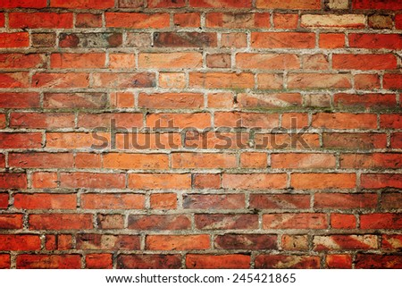 Old red brick wall with dark vignette - stock photo
