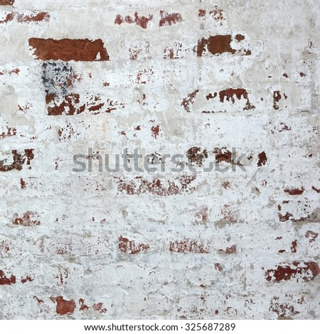 Old Red Brick Wall With Weathered White Plaster Layer Texture Background - stock photo