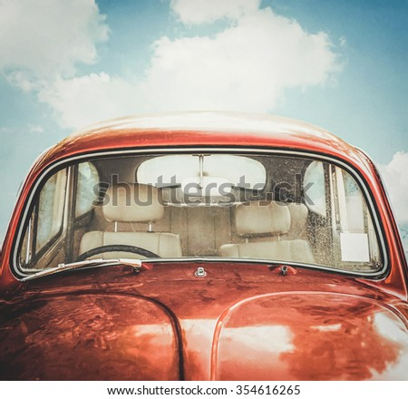 old red car and sky background in retro filter - stock photo