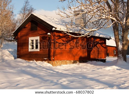 Old red cottage from sweden in wintertime.
