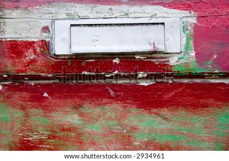 Old red door detail - stock photo