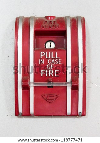 old Red fire alarm pull switch. Isolated on white - stock photo