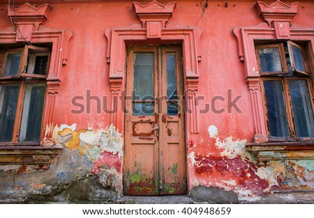 old red house wall with wooden door and window. Exterior and Front Door of a Beautiful Old House. Facade of an old house