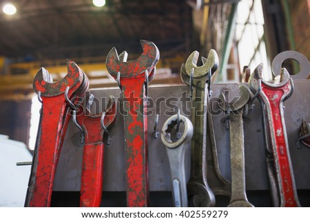 Old red iron wrench set at the factory